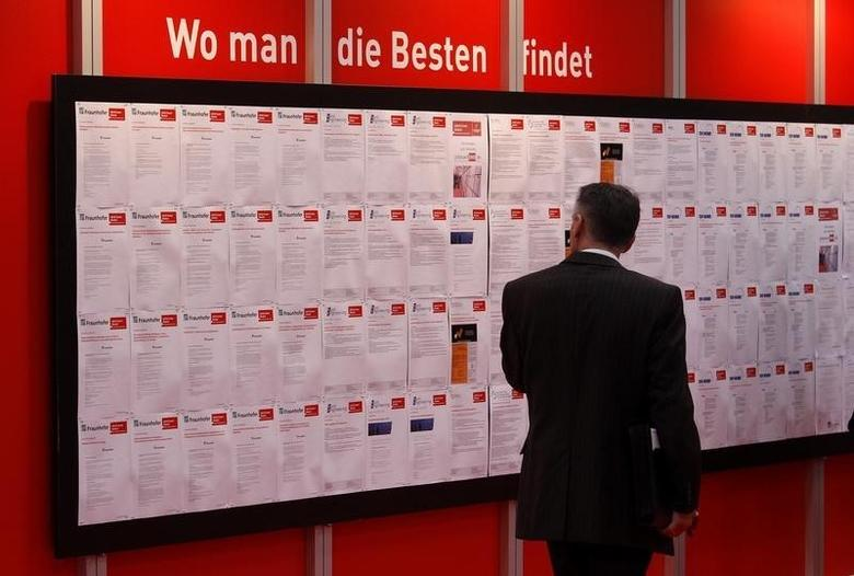 A man read job offers during the first day of the ''Hannover Messe'' industrial trade fair in Hanover April 19, 2010. REUTERS/Tobias Schwarz