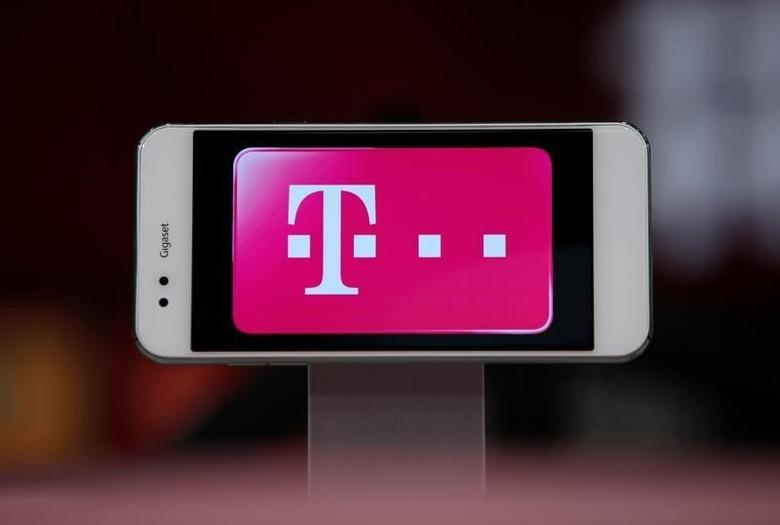 Logo of German telecommunications giant Deutsche Telekom AG is seen on a Gigaset mobile during a news conference of Bayern Munich in Munich, Germany August 6, 2016.     REUTERS/Michaela Rehle