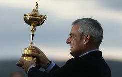 Captain Paul McGinley poses with the Ryder Cup after the closing ceremony of the 40th Ryder Cup at Gleneagles in Scotland September 28, 2014.     REUTERS/Phil Noble/Files