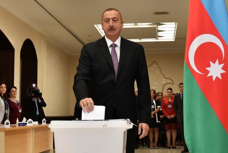 Azerbaijan's President Ilham Aliyev casts his vote during a referendum on extending presidential terms in Baku, Azerbaijan, September 26, 2016. REUTERS/AZERTAC/Vugar Amrullayev/Pool