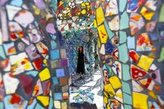 A visitor views the work of artists Gonzalo Duran and Cheri Pann at their Mosaic Tile House in Venice, California U.S., August 26, 2016.   REUTERS/Mario Anzuoni