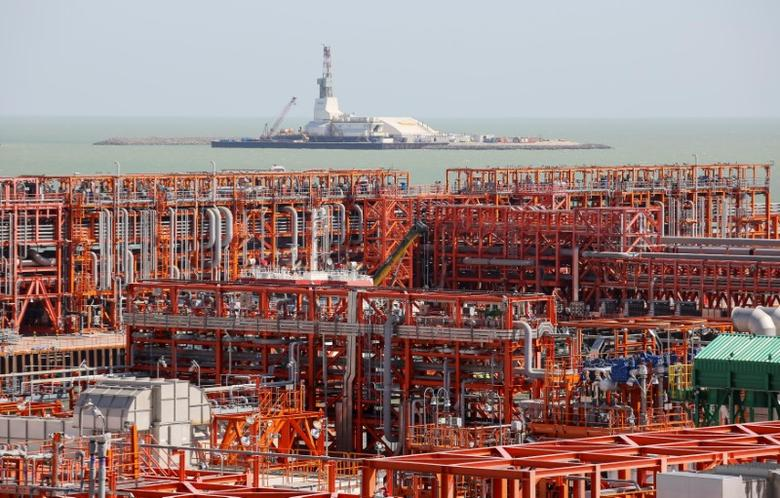 An oil rig (rear) and infrastructure of D Island, the main processing hub, are pictured at the Kashagan offshore oil field in the Caspian sea in western Kazakhstan August 21, 2013. To match Exclusive OIL-CASPIAN/ REUTERS/Stringer/File Photo - RTX2ON37