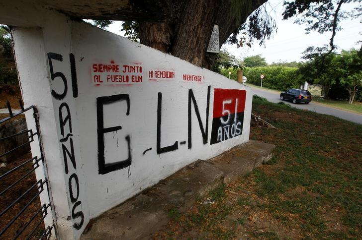 A graffiti, of rebel group Army Liberation National (ELN) is seen at the entrance of the cemetery of El Palo, Cauca, Colombia, February 10, 2016.  REUTERS/Jaime Saldarriaga/Files
