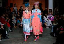 Models present creations by Indian designer Manish Arora as part of his Spring/Summer 2017 women's ready-to-wear collection during Fashion Week in Paris, France September 29, 2016. REUTERS/Gonzalo Fuentes