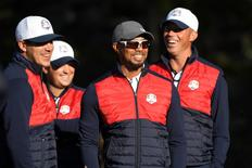Team USA vice captain Tiger Woods shares a laugh with Team USA players Brooks Koepka , Patrick Reed and Matt Kuchar before their official photo on the 10th Fairway at Hazeltine National Golf Club ahead of the 41st Ryder Cup.  Michael Madrid-USA TODAY Sports