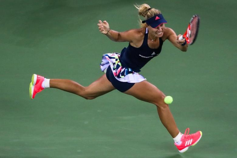 Tennis - Wuhan Open Women's Singles third round - Wuhan, Hubei Province, China - 28/9/16. Angelique Kerber of Germany hits to Petra Kvitova of the Czech Republic. REUTERS/Stringer
