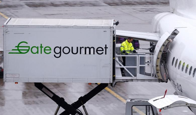 Gate Gourmet staff, part of Swiss airline catering firm Gategroup Holdings, loads a trolley aboard an Airbus A320-214 airplane of Swiss airline at Zurich airport, Switzerland, April 14, 2016.   REUTERS/Arnd Wiegmann/File Photo
