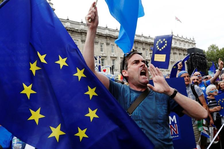 Pro-Europe demonstrators react to Brexit supporters on route during a ''March for Europe'' protest against the Brexit vote result earlier in the year, in London, Britain, September 3, 2016.  REUTERS/Luke MacGregor