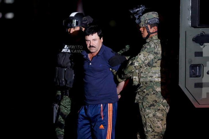 Joaquin ''El Chapo'' Guzman is escorted by soldiers during a presentation in Mexico City, January 8, 2016. REUTERS/Tomas Bravo/Files