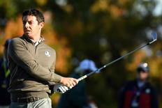 Oct 1, 2016; Chaska, MN, USA;  Rory McIlroy of Northern Ireland plays his shot from the 12th tee during the morning foursome matches in the 41st Ryder Cup at Hazeltine National Golf Club. Mandatory Credit: John David Mercer-USA TODAY Sports