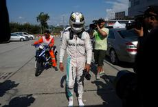 Formula One - F1 - Malaysia Grand Prix - Sepang, Malaysia- 2/10/16  Mercedes' Lewis Hamilton of Britain returns to the paddock after his car caught fire during the race. REUTERS/Edgar Su
