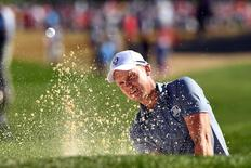 Oct 2, 2016; Chaska, MN, USA;  Danny Willett of England plays a shot from a bunker on the ninth hole during the single matches in 41st Ryder Cup Hazeltine National Golf Club. Mandatory Credit: John David Mercer-USA TODAY Sports/Reuters