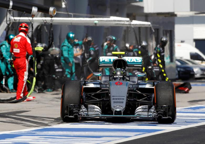 Mercedes driver Nico Rosberg of Germany leaving pit lane after changing his tires during a pit stop while competing the Malaysian Formula One Grand Prix at the Sepang International Circuit in Sepang, Malaysia, Sunday, Oct. 2, 2016. REUTERS/Joshua Paul/Pool