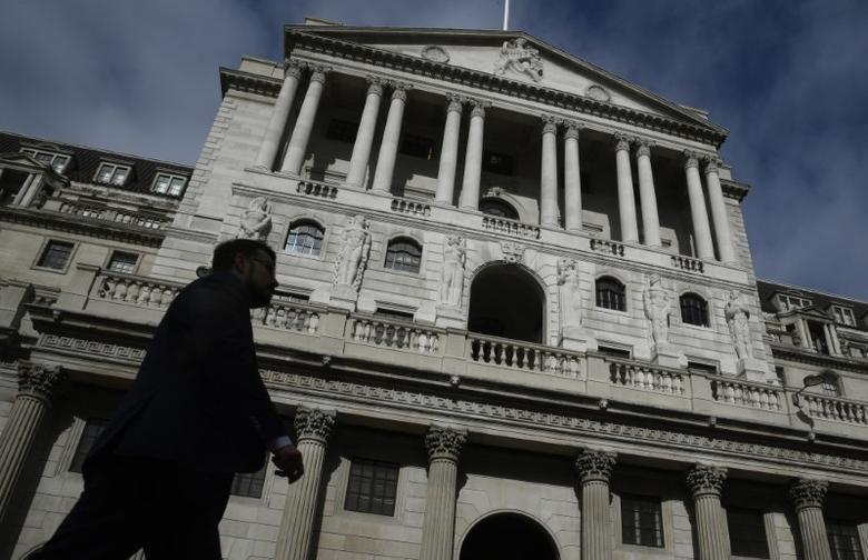 A man walks past the Bank of England in the City of London, in London, Britain September 28, 2016. REUTERS/Toby Melville/Files
