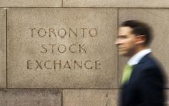 A man walks past an old Toronto Stock Exchange (TSX) sign in Toronto, June 23, 2014. Canada's main stock index was little changed on Monday as weakness in financial and energy shares offset gains in the materials sector.   REUTERS/Mark Blinch