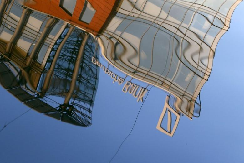 The logo of Deutsche Bank is reflected in the waters of the Moskva river in Moscow, Russia, September 14, 2015. REUTERS/Sergei Karpukhin/File Photo