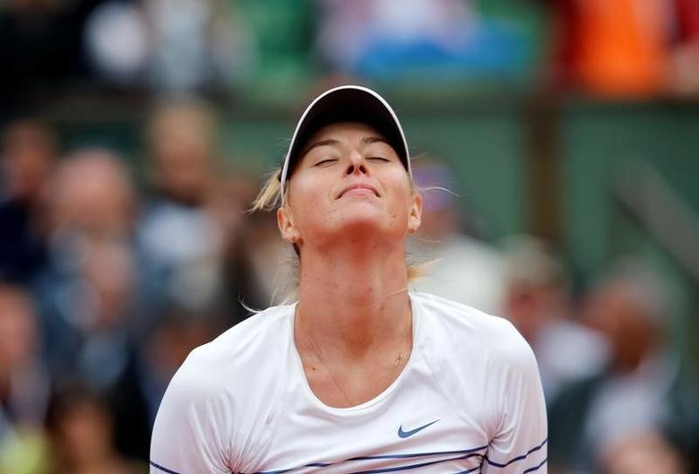 FILE PHOTO -  Maria Sharapova of Russia celebrates after beating Samantha Stosur of Australia during their women's singles match at the French Open tennis tournament at the Roland Garros stadium in Paris, France, May 29, 2015.             REUTERS/Jean-Paul Pelissier/File Photo