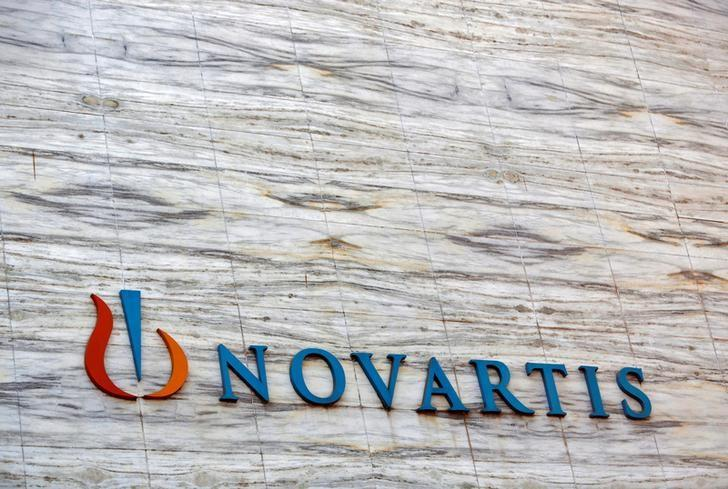 A Novartis logo is pictured on its headquarters building in Mumbai April 1, 2013.  REUTERS/Vivek Prakash/File Photo