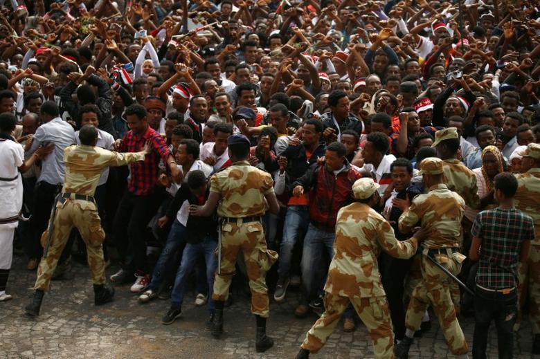 Demonstrators chant slogans while flashing the Oromo protest gesture during Irreecha, the thanksgiving festival of the Oromo people, in Bishoftu town, Oromiya region, Ethiopia, in this file photo taken October 2, 2016. REUTERS/Tiksa Negeri/File Photo