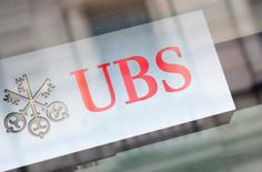 The logo of Swiss bank UBS is seen on a building in Zurich, February 13, 2013. REUTERS/Michael Buholzer/File Photo
