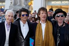 """Members of the Rolling Stones (L-R) Charlie Watts, Ronnie Wood, Mick Jagger and Keith Richards arrive for the """"Exhibitionism"""" opening night gala at the Saatchi Gallery in London, Britain April 4, 2016. REUTERS/Luke MacGregor/File Photo"""