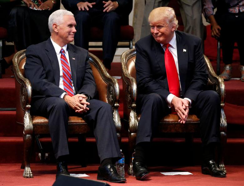Republican presidential nominee Donald Trump (R) and vice presidential nominee Governor Mike Pence attend a gathering of pastors at the New Spirit Revival Center in Cleveland Heights, Ohio, U.S.
