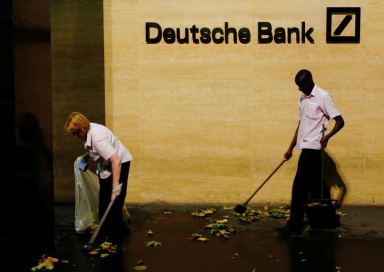 Workers sweep leaves outside Deutsche Bank offices in London, Britain December 5, 2013. REUTERS/Luke MacGregor/File Photo