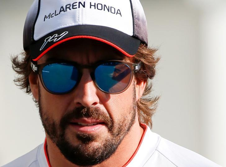 Formula One - Japanese Grand Prix - Suzuka Circuit, Japan- 6/10/16. McLaren's Fernando Alonso of Spain walks in the paddock to attend a news conference.    REUTERS/Toru Hanai