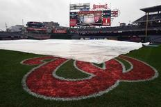Oct 8, 2016; Washington, DC, USA; The tarp covers the infield before game two of the 2016 NLDS playoff baseball game between the Washington Nationals and the Los Angeles Dodgers at Nationals Park. Mandatory Credit: Brad Mills-USA TODAY Sports