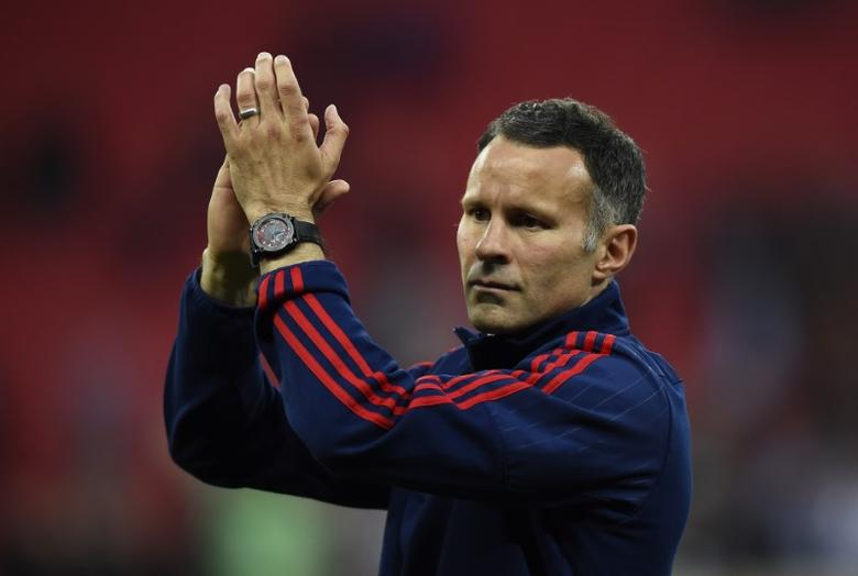 Britain Football Soccer - Crystal Palace v Manchester United - FA Cup Final - Wembley Stadium - 21/5/16Manchester United assistant manager Ryan Giggs celebrates after winning the FA Cup  Reuters / Dylan MartinezLivepicEDITORIAL USE ONLY. No use with unauthorized audio, video, data, fixture lists, club/league logos or ''live'' services. Online in-match use limited to 45 images, no video emulation. No use in betting, games or single club/league/player publications.  Please contact your account representative for further details. - RTSFBI6
