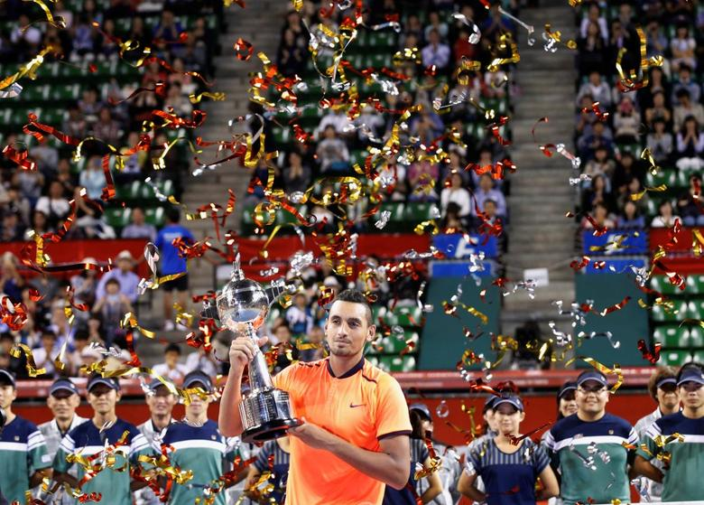 Tennis - Japan Open men's Singles Final Match - Ariake Coliseum, Tokyo, Japan - 09/10/16. Nick Kyrgios of Australia holds his victory trophy. REUTERS/Kim Kyung-Hoon