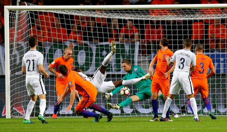 Football Soccer - Netherlands v France - World Cup 2018 Qualifier- Arena Stadion, Amsterdam, 10/10/16.    France's Paul Pogba and Netherland's goalkeeper Maarten Stekelenburg in action.     REUTERS/Michael Kooren
