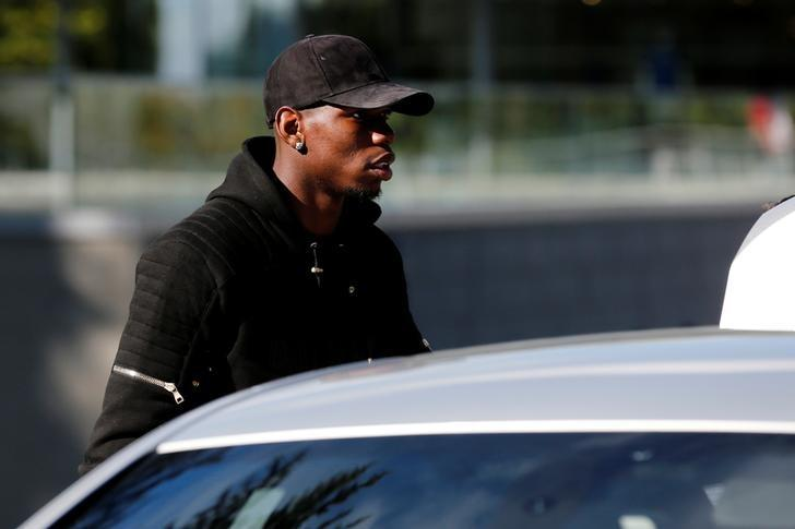 France's midfielder Paul Pogba arrives at the French national football team training base in Clairefontaine, France,  October 3, 2016, as part of their preparation for the upcoming 2018 World Cup Group A qualifier match against Bulgaria. REUTERS/Benoit Tessier