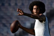 San Francisco 49ers quarterback Colin Kaepernick throws a pass before the game against the San Diego Chargers at Qualcomm Stadium. Mandatory Credit: Jake Roth-USA TODAY Sports