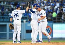 Los Angeles, CA, USA; From left Los Angeles Dodgers second baseman Chase Utley (26),  shortstop Corey Seager (5) and center fielder Joc Pederson (31) celebrate after defeating the Washington Nationals 6-5 in game four of the 2016 NLDS playoff baseball series at Dodger Stadium. Mandatory Credit: Jayne Kamin-Oncea-USA TODAY Sports