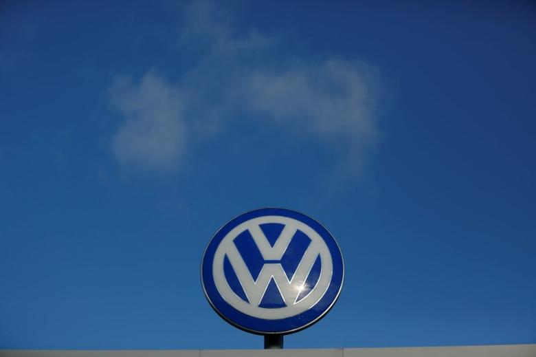 A Volkwagen compnay logo sits atop the VW factory in Wolfsburg, Germany November 20, 2015. REUTERS/Ina Fassbender