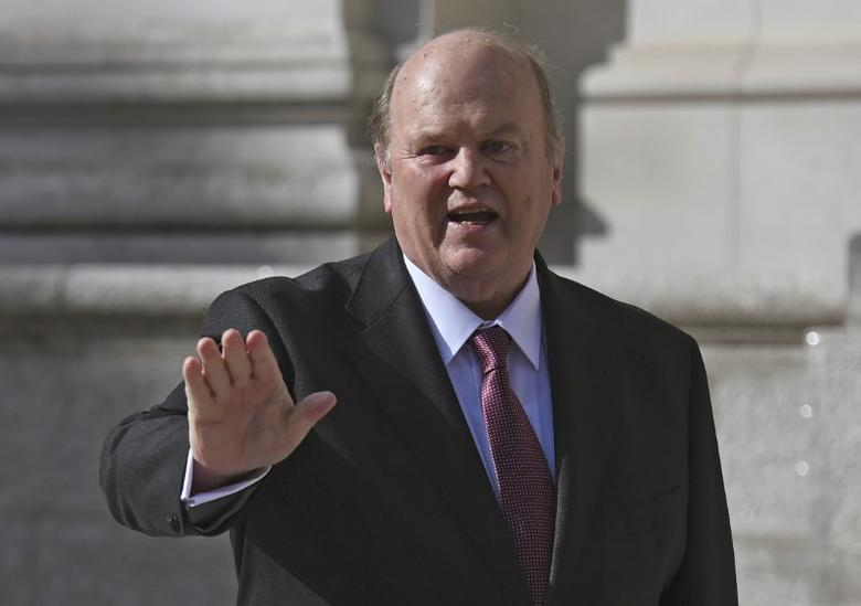 Ireland's Minister for Finance Michael Noonan gestures on the steps of Government Buildings in Dublin, Ireland October 11, 2016.  REUTERS/Clodagh Kilcoyne