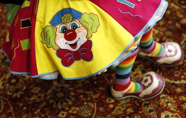 A clown attends a seminar at an annual convention in Northbrook, Illinois, U.S. March 26, 2014. REUTERS/Jim Young/Files