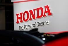 A Honda logo is seen on media day at the Paris auto show, in Paris, France, September 29, 2016. REUTERS/Benoit Tessier