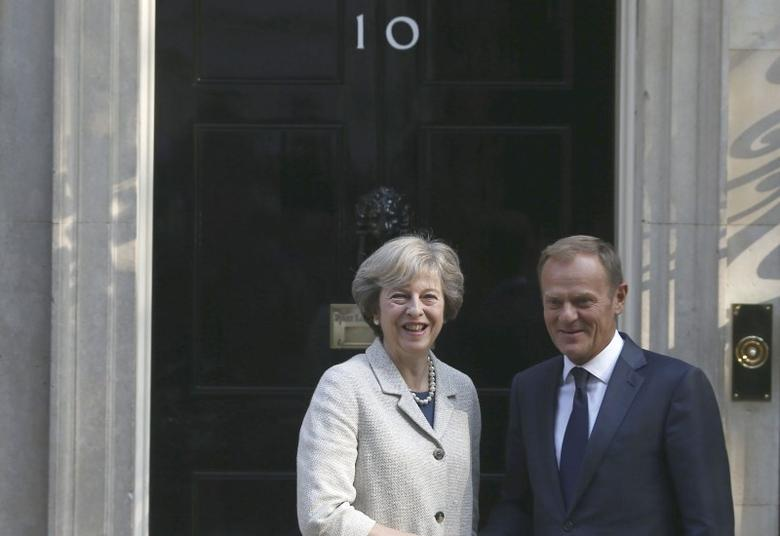 Britain's Prime Minister Theresa May (L) greets European Council President Donald Tusk in Downing Street in London, Britain September 8, 2016. REUTERS/Neil Hall - RTX2OM8V