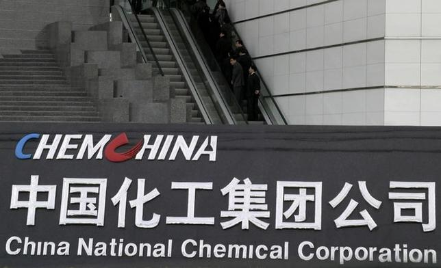 People use an escalator outside the headquarters of ChemChina (China National Chemical Corporation) in Beijing, China, February 4, 2005. REUTERS/Stringer/File Photo