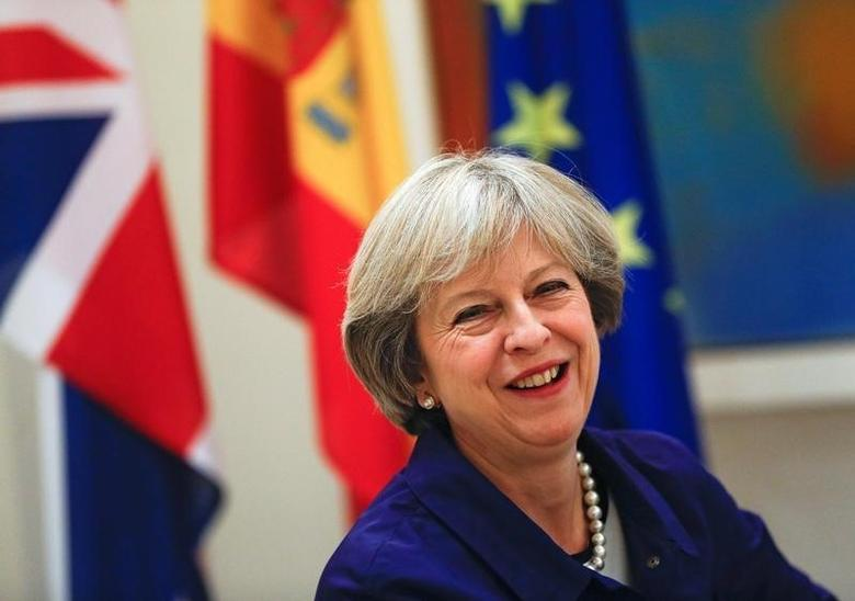 British Prime Minister Theresa May smiles during a meeting with Spain's acting Prime Minister Mariano Rajoy at the Moncloa Palace in Madrid, Spain, October 13, 2016.   REUTERS/Juan Medina