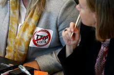 A deputy wears a sticker against the Transatlantic Trade and Investment Partnership (TTIP) and Comprehensive Economic and Trade Agreement (CETA) during a debate on CETA, a planned EU-Canada free trade agreement, at the Walloon regional parliament in Namur, Belgium, October 14, 2016. REUTERS/Francois Lenoir