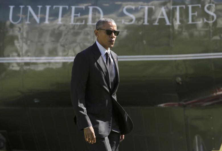 U.S. President Barack Obama walks from Marine One as he returns to the White House in Washington, U.S., October 14, 2016. REUTERS/Joshua Roberts