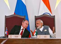 India's Prime Minister Narendra Modi (R) speaks with Russian President Vladimir Putin during exchange of agreements event after India-Russia Annual Summit in Benaulim, in the western state of Goa, India, October 15, 2016. REUTERS/Danish Siddiqui