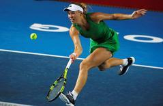 Tennis - Hong Kong Open semi-finals - Caroline Wozniacki of Denmark v Jelena Jankovic of Serbia - Hong Kong, China - 15/10/16. Wozniacki returns a shot. REUTERS/Bobby Yip