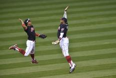 Oct 15, 2016; Cleveland, OH, USA; Cleveland Indians shortstop Francisco Lindor (left) high fives center fielder Rajai Davis (right) after defeating the Toronto Blue Jays in  game two of the 2016 ALCS playoff baseball series at Progressive Field. Cleveland won 2-1. Mandatory Credit: David Richard-USA TODAY Sports