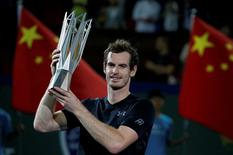 Tennis - Shanghai Masters tennis tournament final - Roberto Bautista Agut of Spain v Andy Murray of Britain - Shanghai, China - 16/10/16. Murray poses with the trophy after winning tournament. REUTERS/Aly Song