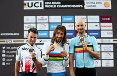 First-placed Peter Sagan of Slovakia (C), second-placed Mark Cavendish of Britain (L) and third-placed Tom Boonen of Belgium pose with their medals on the podium at the end of Men Elite Road Race in the UCI Road World Championships 2016, in Doha, Qatar, October 16, 2016. REUTERS/Ibrahem Alomari