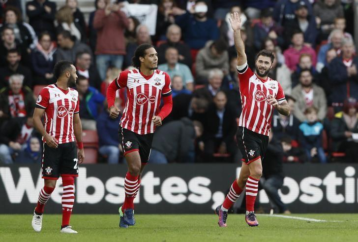 Britain Football Soccer - Southampton v Burnley - Premier League - St Mary's Stadium - 16/10/16Southampton's Charlie Austin celebrates scoring their third goal with Virgil van Dijk and Nathan RedmondReuters / Stefan WermuthLivepic